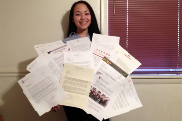Brandi Moore with her 13 college acceptance letters
