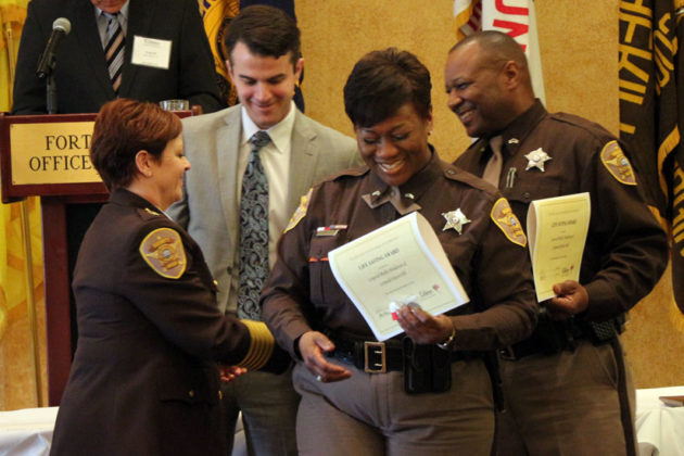 Cpls. Phyllis Henderson and Edwin Hill honored with the Lifesaving Award