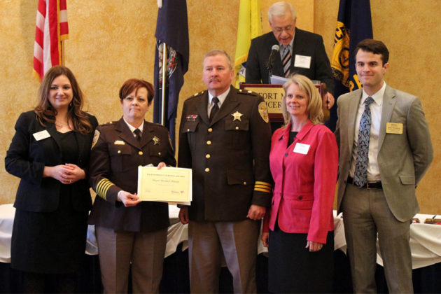 Sheriff's Office Maj. Michael Pinson, center, honored with the Meritorious Service Award
