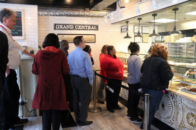 Dozens wait in line for a slice of pizza at the new Wiseguy in Rosslyn