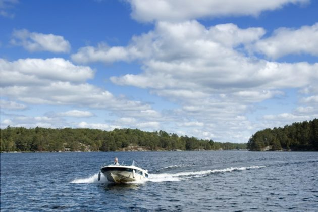 One person boating on a Ontario Lake