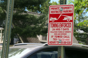 The parking lot sign at 3033 Wilson Blvd