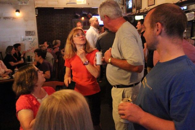 Jay's Saloon co-owner Kathi Moore talking with customers