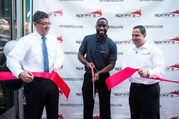 Pierre Garçon cuts the ribbon on SpinFire Pizza in Rosslyn (photo credit Joy Asico)