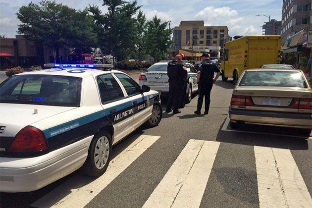 Police investigate a minor accident involving a food truck