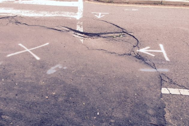 Sinkhole in early June following temporary repairs (photo courtesy Joe Keeley)