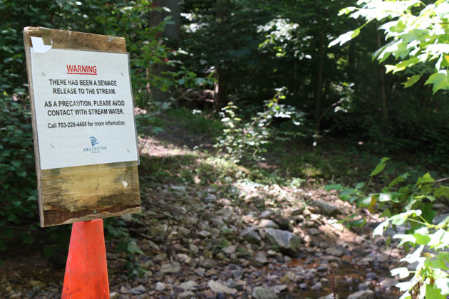 Signs line the Donaldson Run trail.