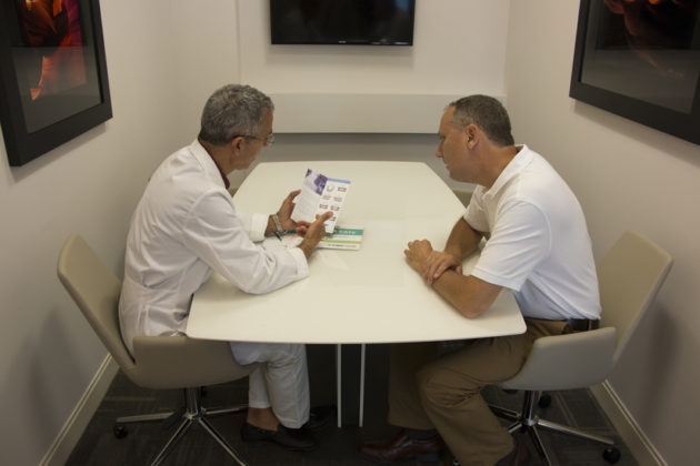Dr. Adili talking to a patient about his options