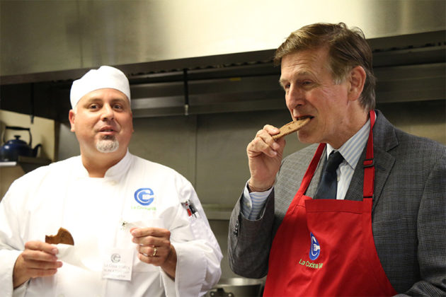 Rep. Don Beyer eats a chocolate chip and cricket cookie.
