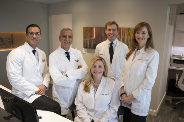 The team of dentists at Ideal Dental Solutions. From left, Dr. Sepahi, Dr. Adili, Dr. Forbes, Dr. Enoch. Seated: Dr. Sumner.