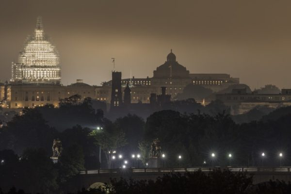 Foggy view of D.C., the Capitol and the Memorial Bridge from Arlington (Flickr pool photo by Kevin Wolf)