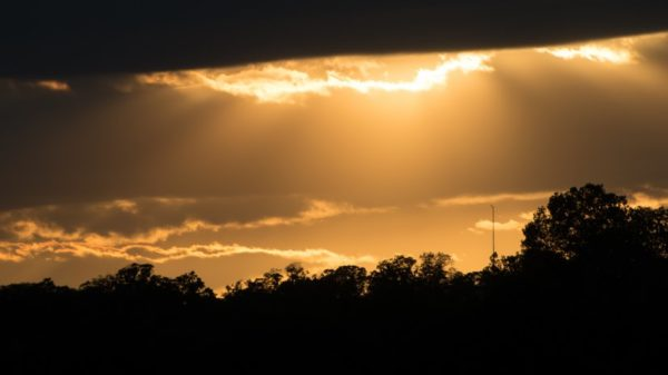 Sun rays peeking through clouds on the Potomac (Flickr pool photo by John Sonderman)