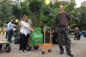 Two people take a tree home during the Crytal City's Bid Tropical Storm (Courtesy of Crystal City BID)