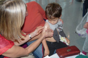 A child receives a flu shot (Courtesy of Arlington County)