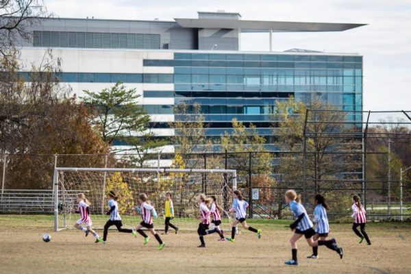 Children playing soccer near Arlington Hall (Flickr pool photo by Dennis Dimick)
