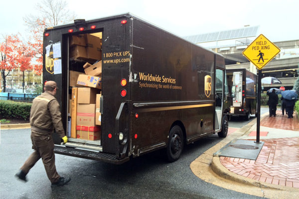 UPS trucks overloaded with packages, at the Pentagon Row shopping center
