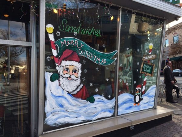 Christmas / Santa Claus illustration in the window of Whitlow's in Clarendon