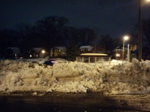 Snow piled in front of a bus stop (photo courtesy Alex Chamandy)