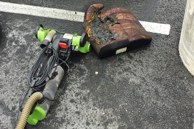 A vacuum cleaner and a charred seat found behind the car's trunk