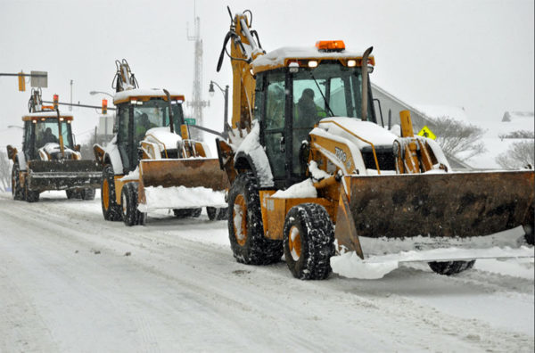 Front end loaders clearing snow during the January 2016 blizzard (Flickr pool photo by Starbuck77)