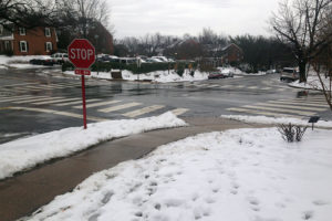 Snow, ice and rain on a road and sidewalk in Fairlington