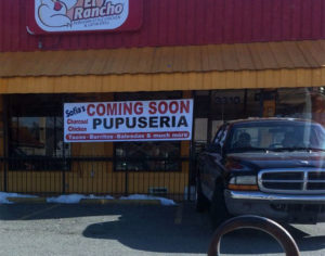 Sign announcing a new restaurant on the former El Rancho Peruvian Chicken eatery