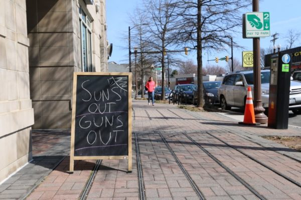"""Sun's Out, Guns Out"" sign in Ballston"