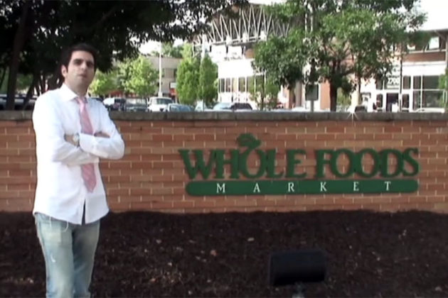 The Clarendon Whole Foods wall, during happier times (via YouTube)
