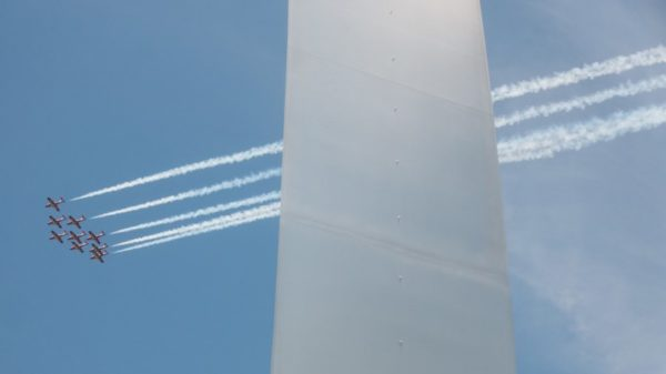 Canadian Forces Snowbirds fly over D.C., with the Air Force Memorial in the foreground