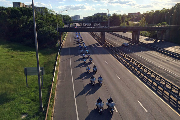 Police motorcycle officers / motorcade on I-395 on 5/13/16 (file photo)