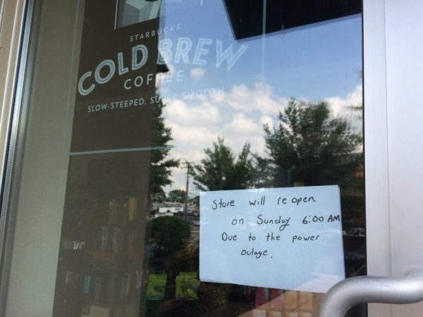Sign on the door of the Clarendon Starbucks, which is closed due to the Market Common Clarendon power outage