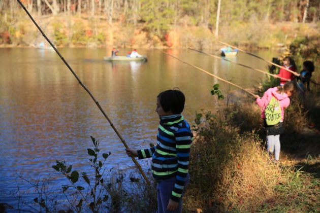 Kids fishing in the lake at the Arlington Outdoor Lab (courtesy photo)