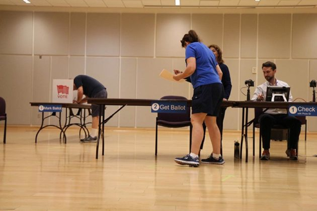 Voters receiving their ballots