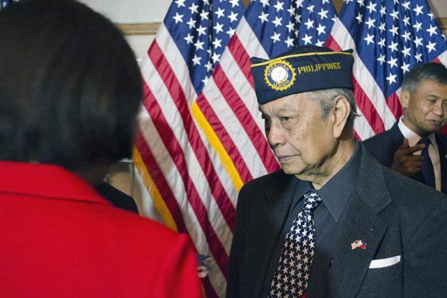 Rudy Panaglima discusses with Hawaii Senator Mazie K. Hirono