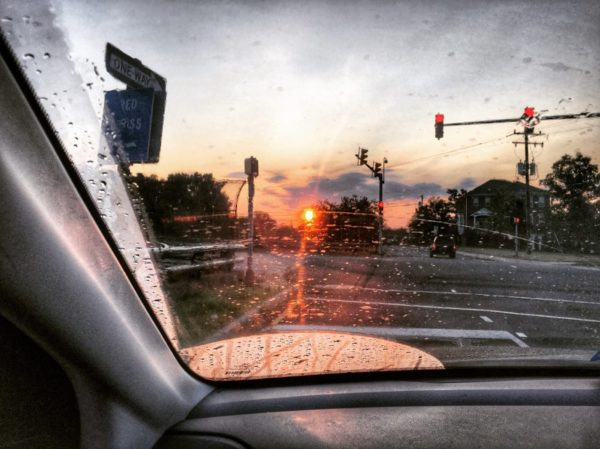 Post-rainstorm summertime sunrise while driving (Flickr pool photo by Dennis Dimick)