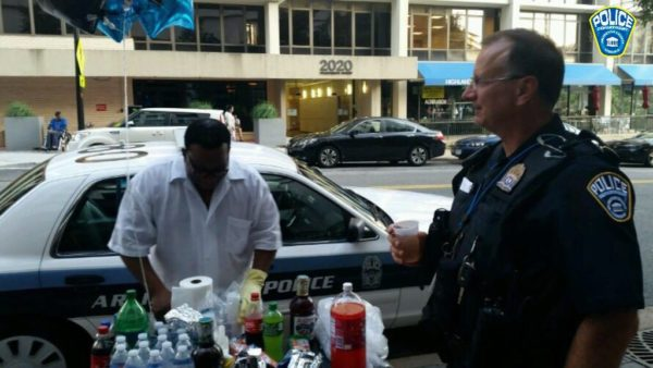 A man serves food and drinks for Arlington County police officers (photo courtesy ACPD)