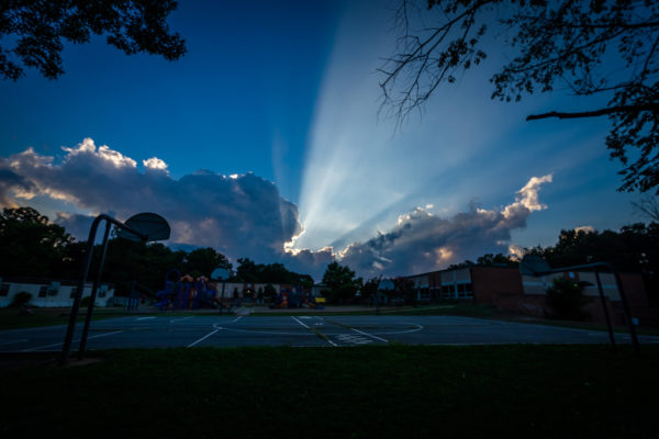 Clouds and rays of sunlight above Claremont Immersion School (Flickr pool photo by Erinn Shirley)