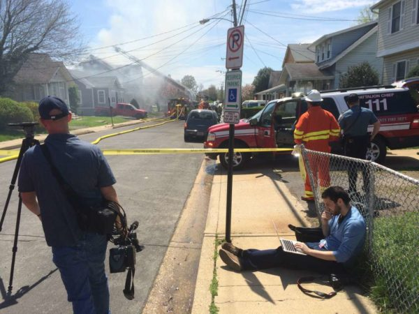 Ethan Rothstein reporting on a house fire in April 2015