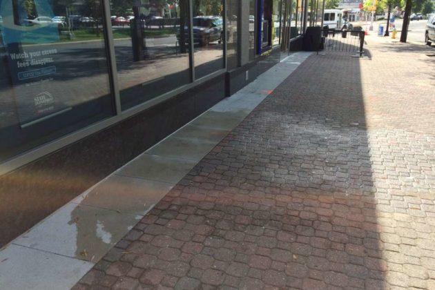 Photo taken Wednesday showing aftermath of SUV crash on Clarendon sidewalk