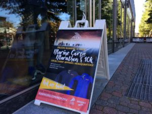 Marine Corps Marathon sign outside Pacers Clarendon store