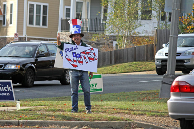 "Man with a ""please vote"" sign on Washington Blvd, Election Day 2016"