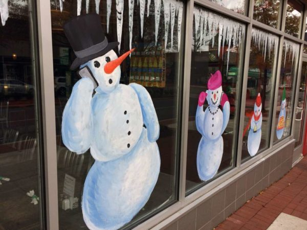 Snow man painted on a restaurant window in Shirlington
