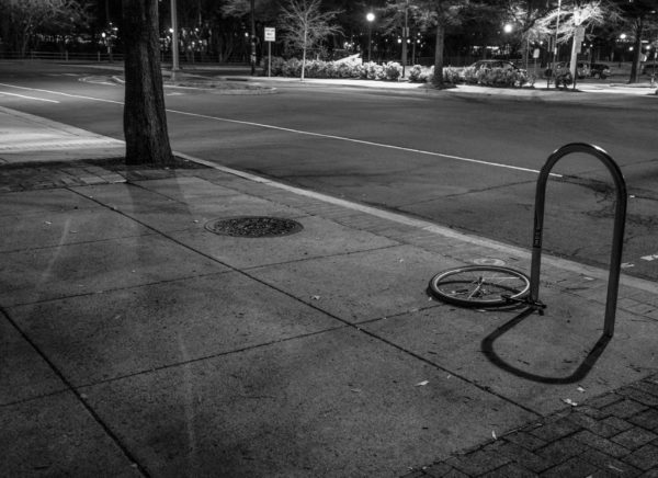 A bike tire is all that remains of a bike parked in Shirlington (Flickr pool photo by Erinn Shirley)
