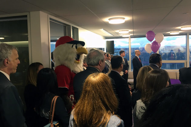 The audience included people in business suits and Washington Nationals mascot Screech