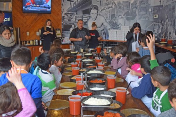 Bronx Pizza owner Mike Cordero teaches Arlington students how to make pizza (photo courtesy Alexis Fedoroff)
