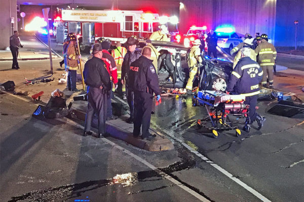Rescuers work to free driver from SUV that fell off the side of a I-395 overpass near the Pentagon (courtesy photo)