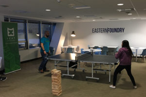 People playing table tennis at Eastern Foundry