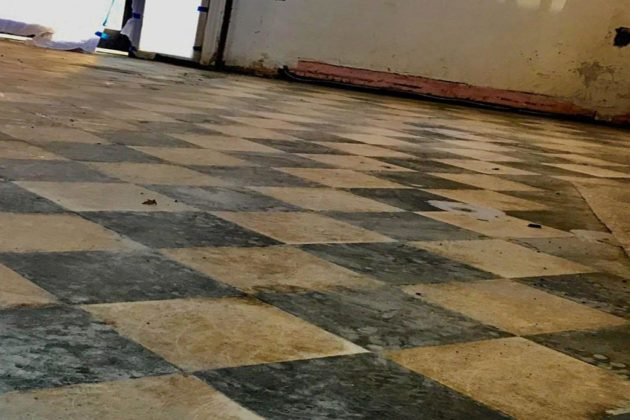 The original marble tile floor, discovered during construction (photo via Facebook)