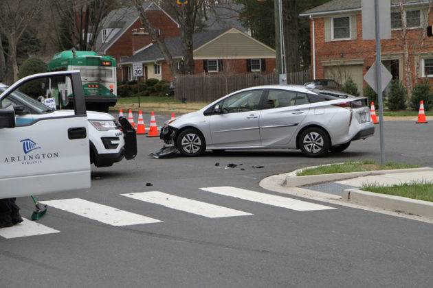 Police said the Prius misjudged the speed of traffic and collided with the black car