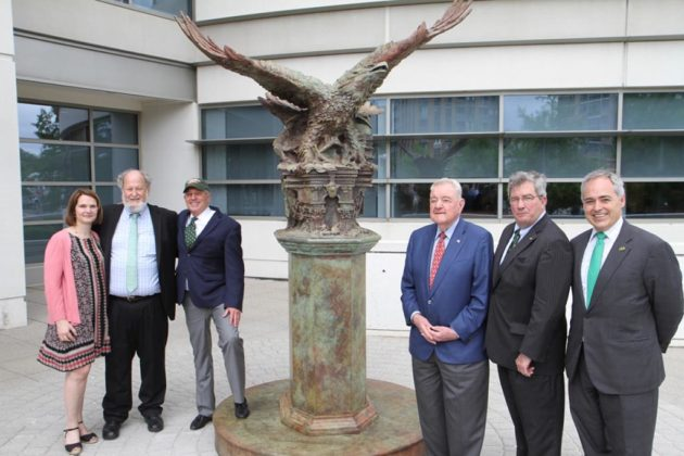 Dignitaries at George Mason University's law school pose with the Bill of Rights Eagle